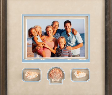 photo of family on beach with seashells
