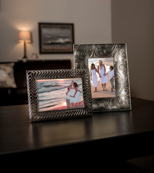 Tabletop with two photo frames shown.