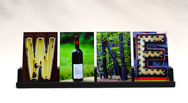 Art gift. Four tiles featuring images of images that make the letters to spell WINE