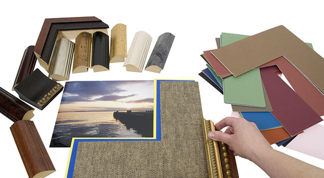 Deciding on a framing project with an assortment of colored matboard and frame samples