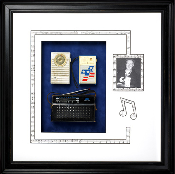 Custom framed shadowbox design with vintage radios, a picture of radio operator and musical notes cut into the matting.