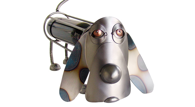 Metal dog sculpture that serves as a wine bottle holder for gifts.