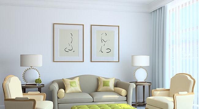 Modern living-room interior. Furniture and custom framed artwork beautifully arranged.
