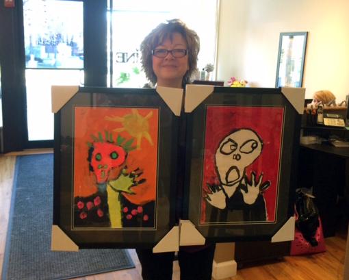Happy customer with custom framing for her artwork