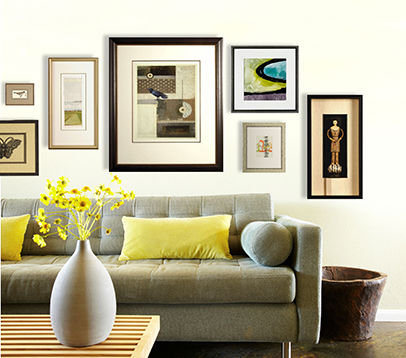 Couch with multiple pieces of custom framed artwork hung above
