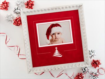 framed photo of baby in Santa hat