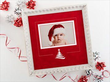 framed photo of baby in Santa hat