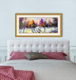 framed landscape over bed