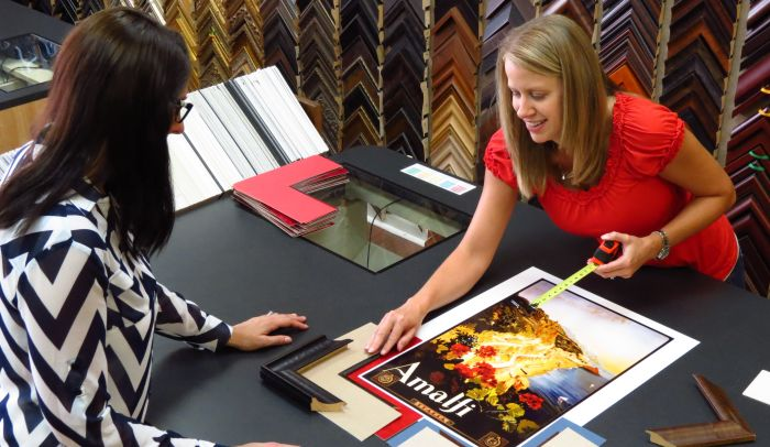 Picture of customer and The Great Frame Up employee designing an Amalfi print in a The Great Frame Up location.