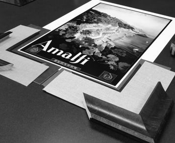 Print of Amalfi laying on counter with custom framing materials surrounding it during the design process.