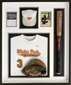 baseball shadowbox with bat, glove, jersey, hat and pictures.