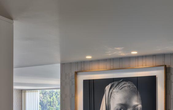 Large custom framed artwork in contemporary room setting.