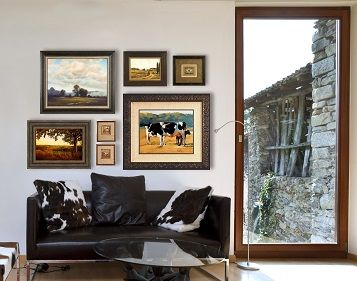 Room setting with multiple pieces of art correctly illuminated.