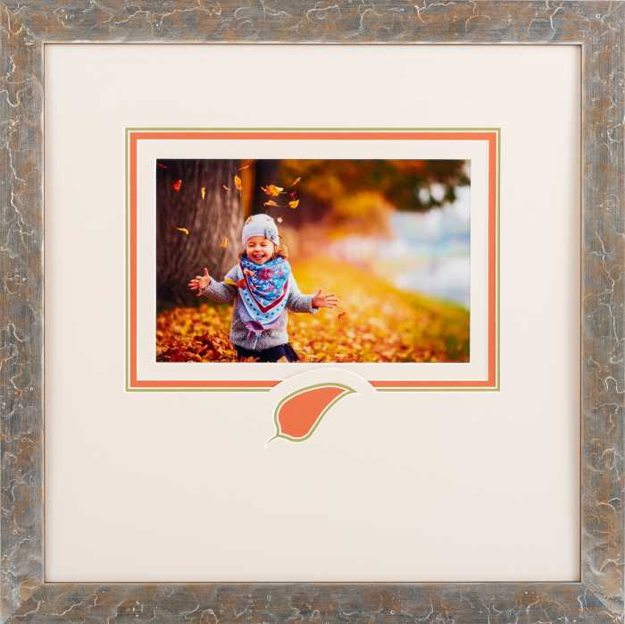 Framed girl playing in leaves