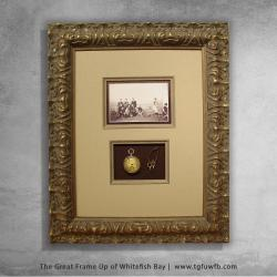 Framed antique pocket watch and photo